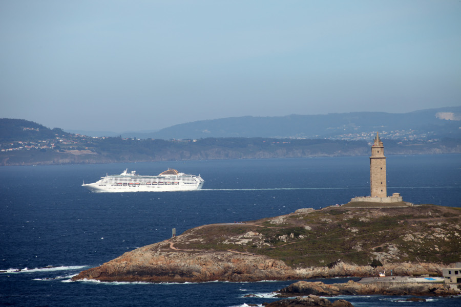 Cruise liner sailing in front of the Tower of Hercules
